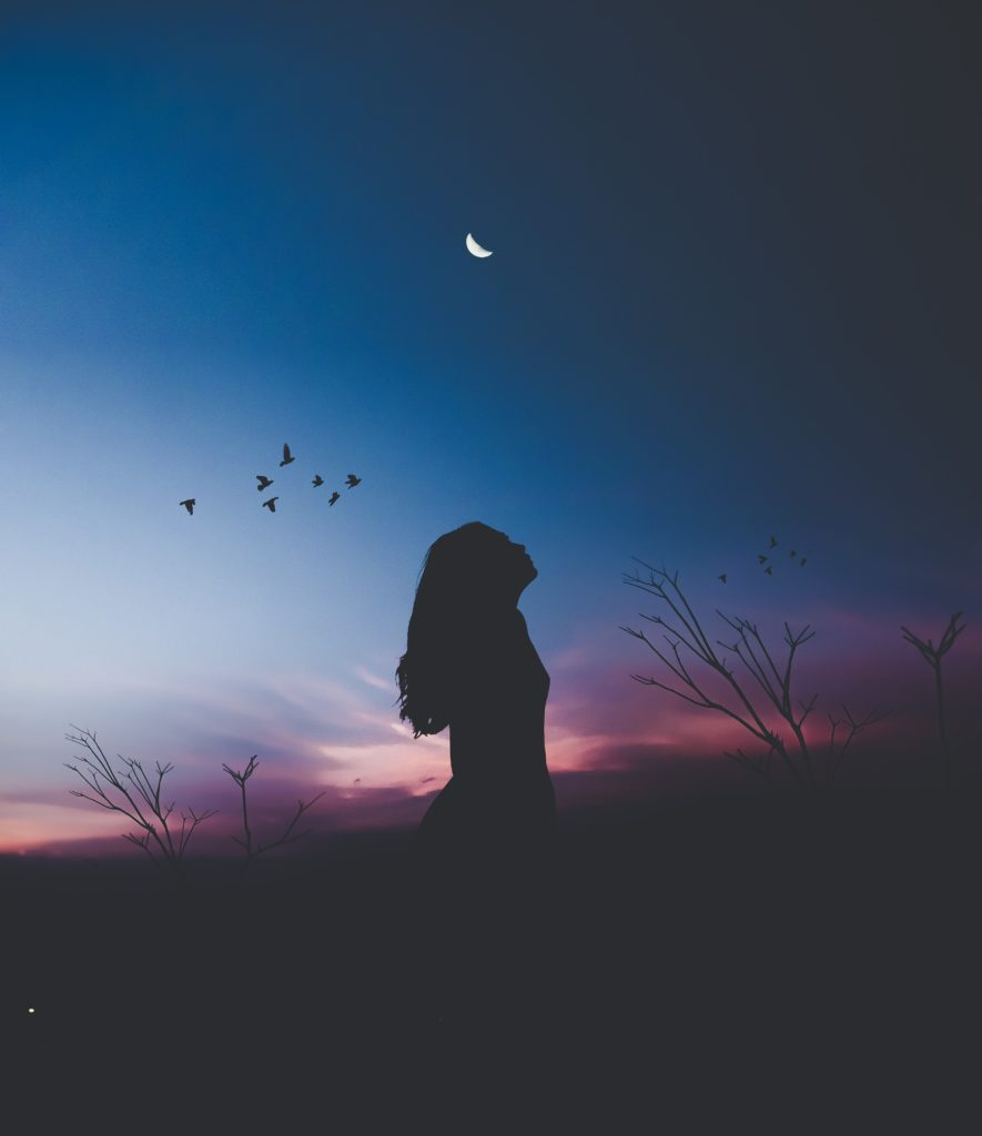 a Sleepless girl looks at night sky
